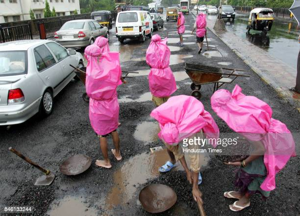 Potholes are being repaired during rains by BMC at Andheri flyover
