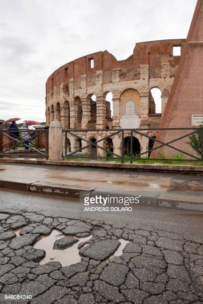 Potholes are pictured on a road along the Colosseum in downtown Rome on April 12 2018 Romes roads problems have been existing for years due to...