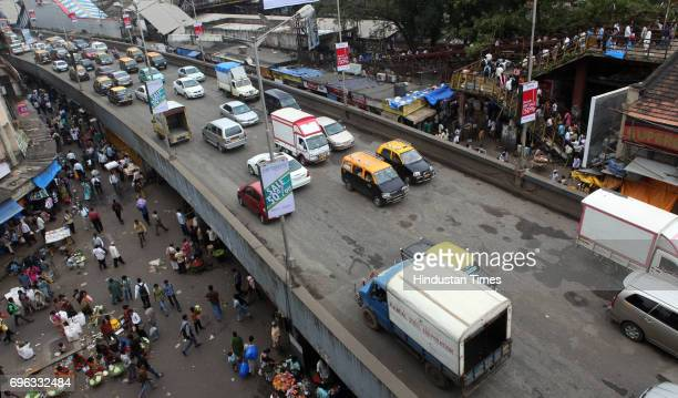Potholes on Dadar flyover on Tulsi Pipe Road are being filled up