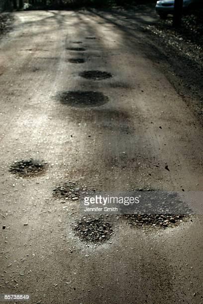 potholes - pothole stock photos and pictures