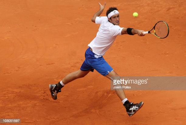 Potito Starace of Italy returns a backhand during his Quarter Final match against Juergen Melzer of Austria during the International German Open at...