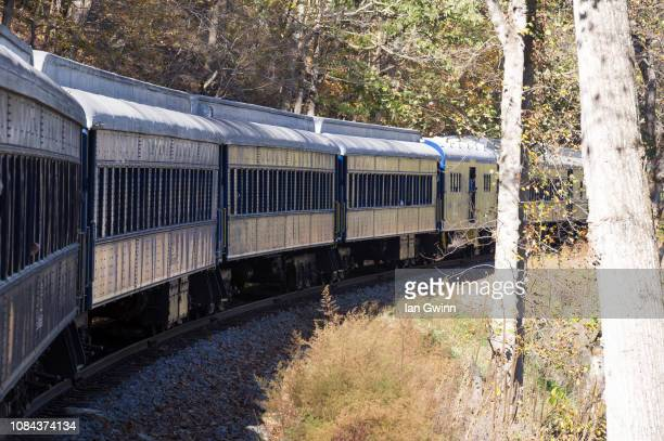 potomac eagle coaches in a curve - ian gwinn stock photos and pictures