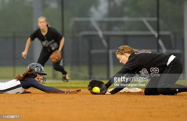 Potomac Falls' Catie McCay stops the ball but just misses the tag as Woodgrove's Ashey Cole slides safely back to second in the seventh innning of...