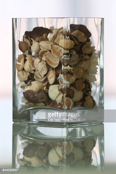 Potpourri In Glass Container On Table
