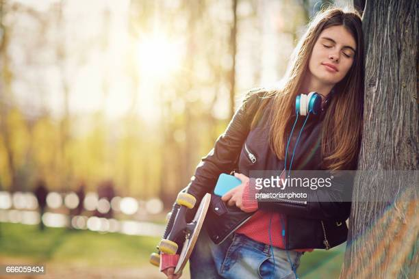 potrait of a beautiful teen girl dreaming in the park - nice girls pic stock photos and pictures