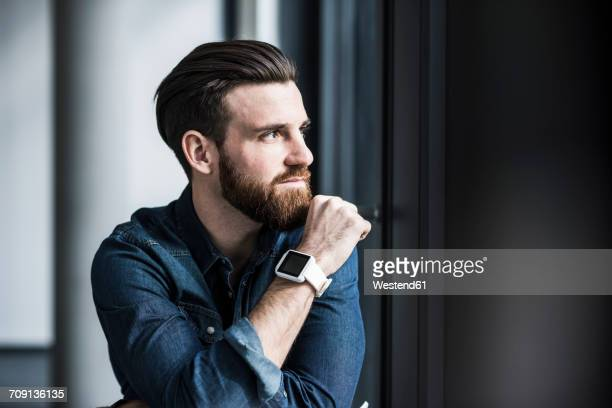 Potrait of a young businessman wearing smart watch