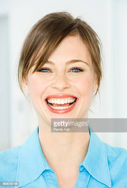Potrait of a young woman laughing, close-up
