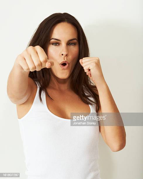 Potrait of girl punching towards the camera