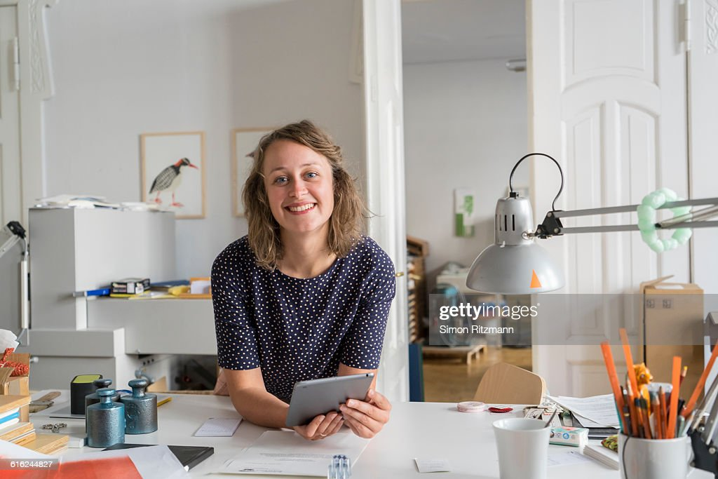 Potrait of happy businesswoman with digital tablet : Stock Photo