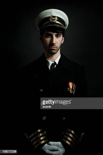 Potrait of Male Navy Ship Captain, Isolated on Black