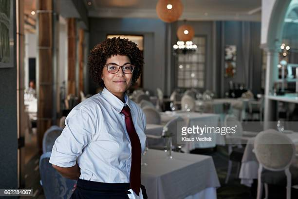 potrait of proud waiter at fine restaurant - waiter stock pictures, royalty-free photos & images