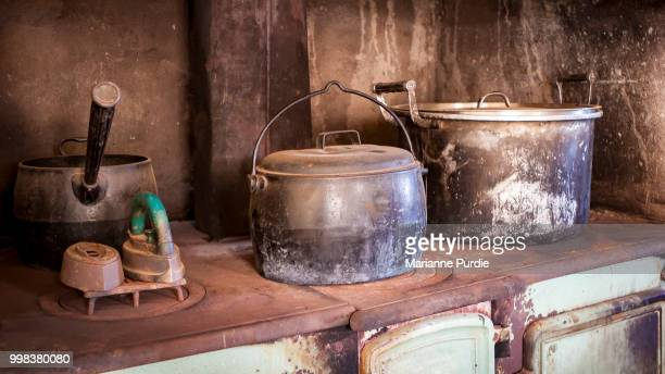 pots and an iron on an old wood stove - marianne koch stock-fotos und bilder