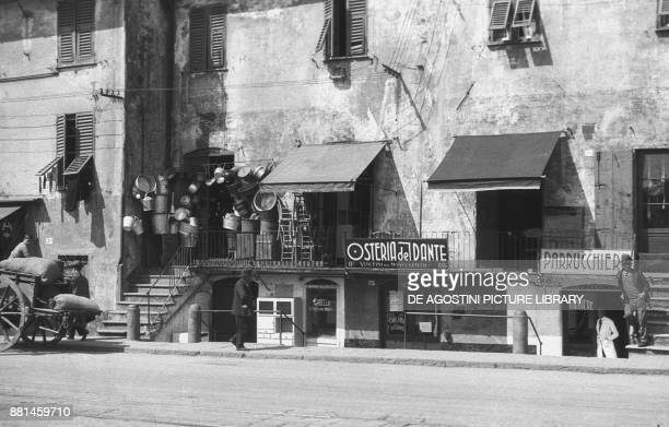 Pots and chairs shop Osteria del Dante hairdresser April 6 Genoa Italy 20th century