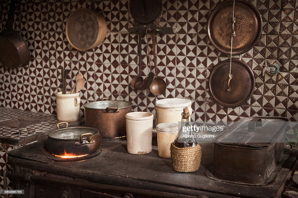 Pots and pans on cast iron stove in kitchen : Stock Photo