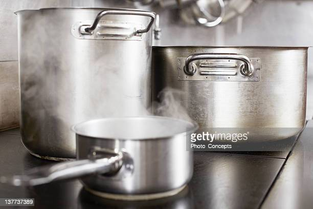 pots boiling on stove - cooking pan stock pictures, royalty-free photos & images