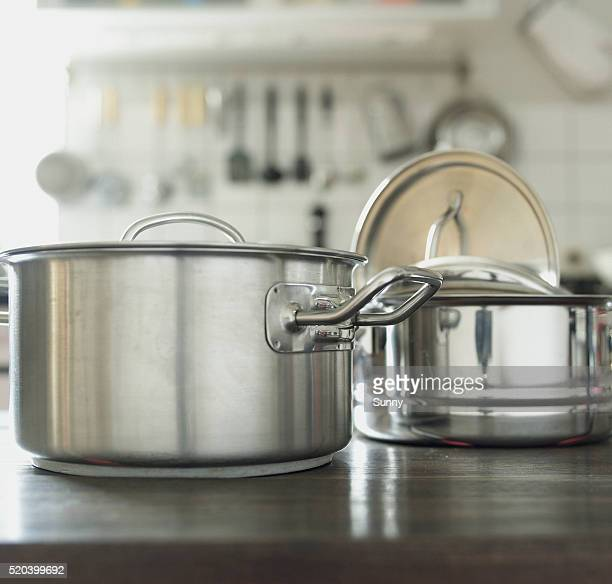 pots in kitchen - cooking pan stock pictures, royalty-free photos & images