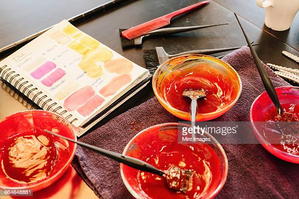 pots of hair colour and a colour chart in a hair salon. - hair colourant stock pictures, royalty-free photos & images