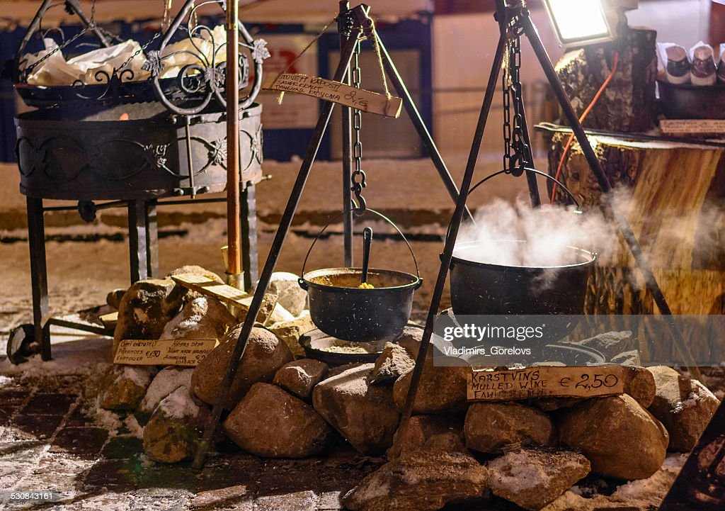 Pots of hot wine and soup at traditional Christmas night : Stock Photo