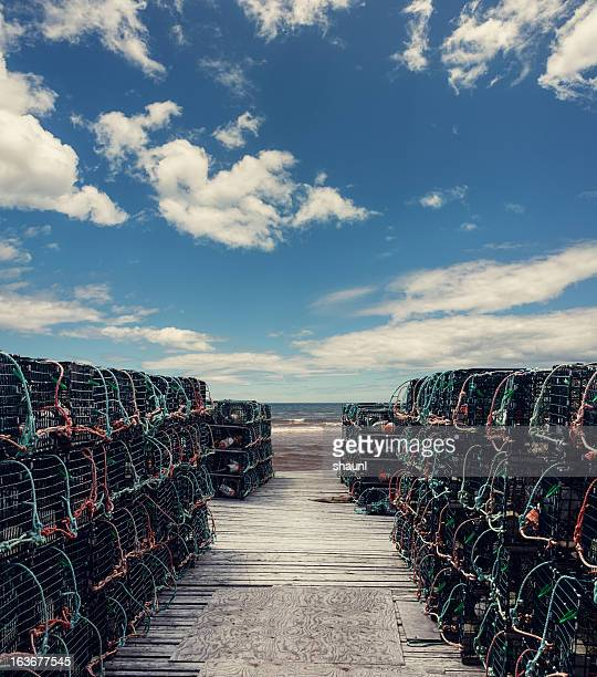 pots on the wharf - lobster fishing stock photos and pictures