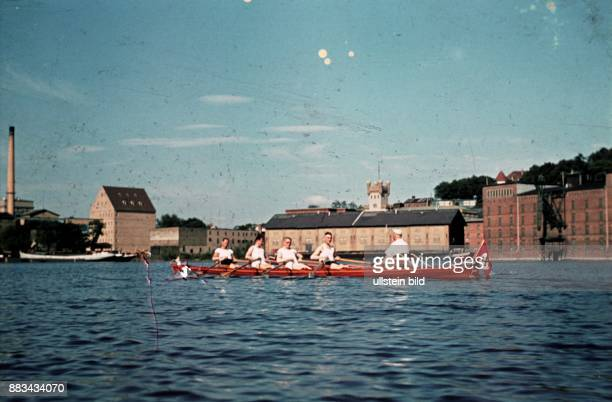 Potsdam boat with Swastika at the Havel river in the Teltower Vorstadt with granary in the background