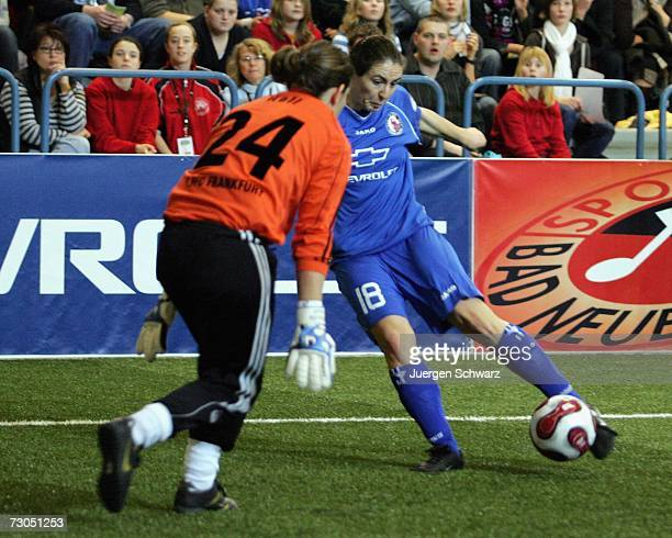 Potsdam's Aferdita Kameraj scores against Frankfurt's goalkeeper Ursula Holl during the Women's German Indoor Cup match between 1 FFC Frankfurt and 1...