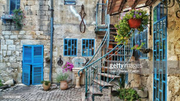 potted plants and steps at yard - israel stock-fotos und bilder