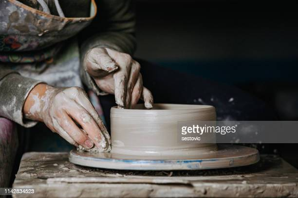potter at work - sculptor stock pictures, royalty-free photos & images