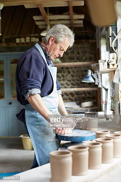 potter cutting jars off throwing batts - richard drury stock pictures, royalty-free photos & images