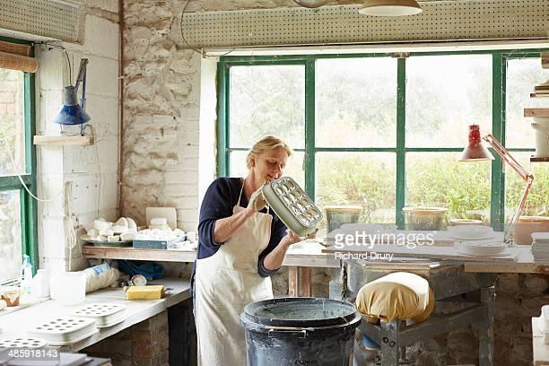 Potter glazing rectangular egg rack