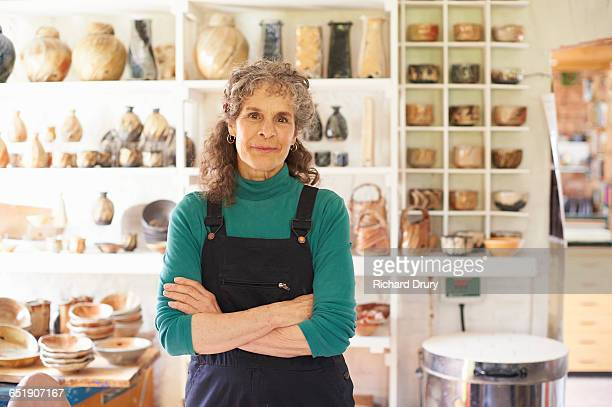 potter in her workshop - one senior woman only stock pictures, royalty-free photos & images