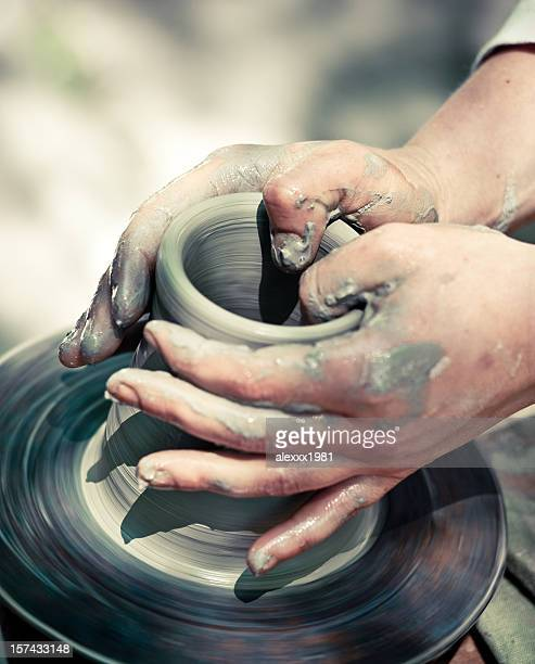 Potter making a jug out of clay