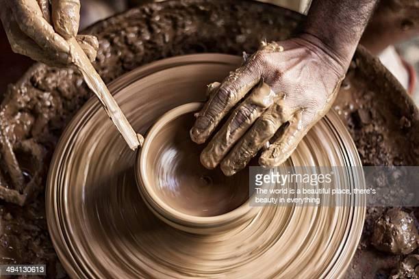 A potter making a pot