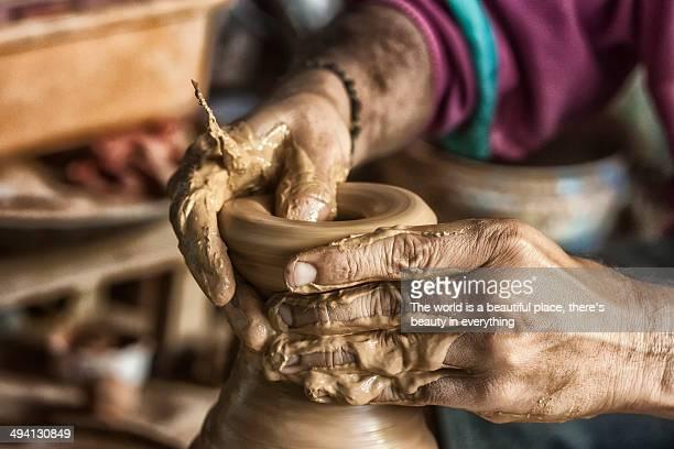 A potter making an earthen pot
