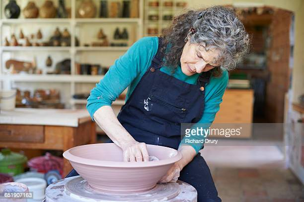 potter making bowl - pottery stock pictures, royalty-free photos & images