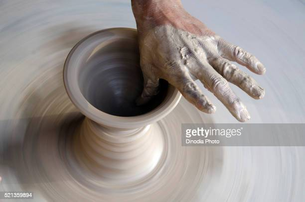 potter making earthen pot in bikaner at rajasthan, india, asia - potter stock pictures, royalty-free photos & images