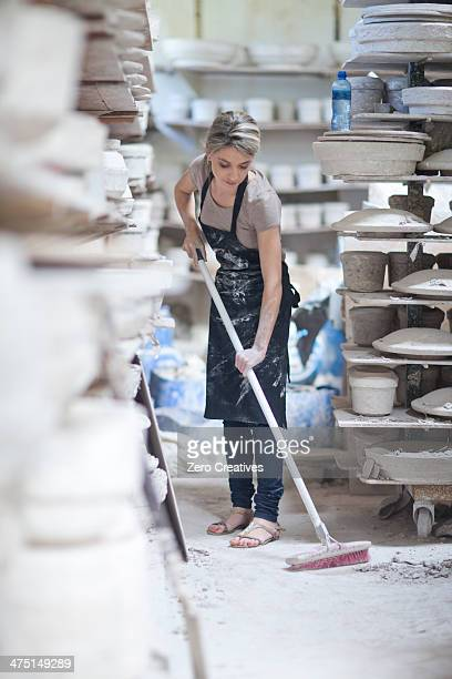 potter sweeping floor at crockery factory - sweeping stock pictures, royalty-free photos & images