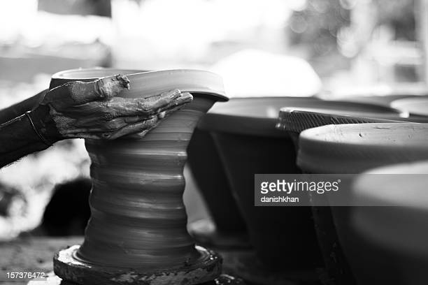 Potter's Hand Making Clay pot Black and white