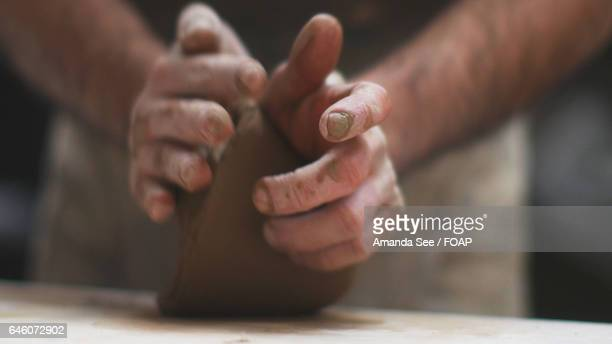 Potter's hand making pottery