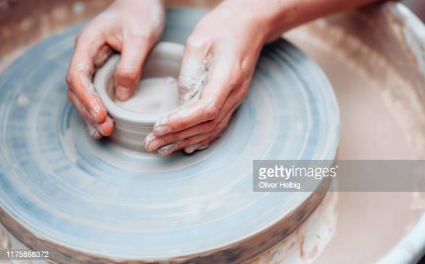 potters hands on wheel - sculptor stock pictures, royalty-free photos & images