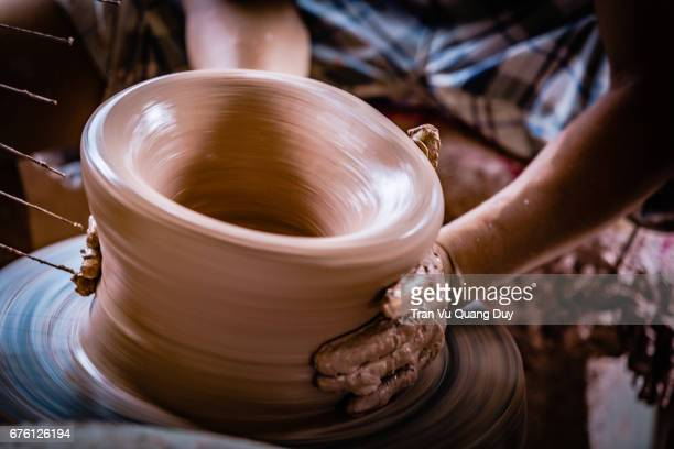 potter's hands - clay stock photos and pictures