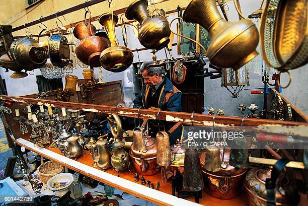 Pottery and copper objects openair flea market El Rastro Madrid Spain