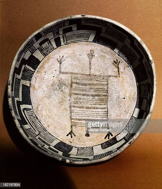 Pottery bowl with schematic human figure and black on white geometric design, USA. Mogollon/Anasazi culture. C 1000 AD.