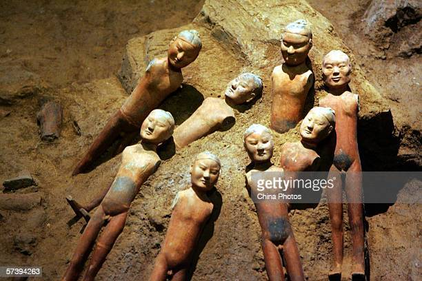 Pottery figurines excavated from Hanyang Tomb are seen at the Hanyang Mausoleum Underground Museum on April 20 2006 in Xian of Shaanxi Province China...