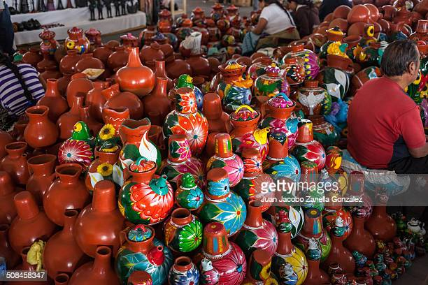 Pottery for sale at the traditional Holy Week arts and crafts outdoor market in Uruapan, Mexico.