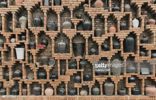 Pottery in brick wall