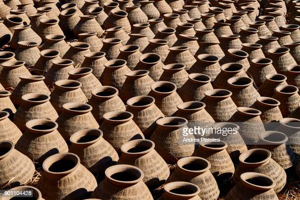 pottery in yandabo village, myanmar - myanmar culture stock photos and pictures
