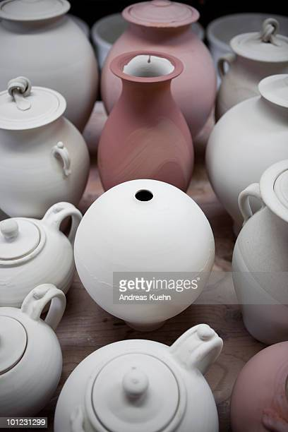 Pottery lined up after being glazed.