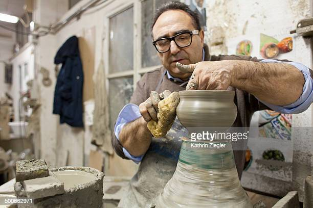 pottery maker at work