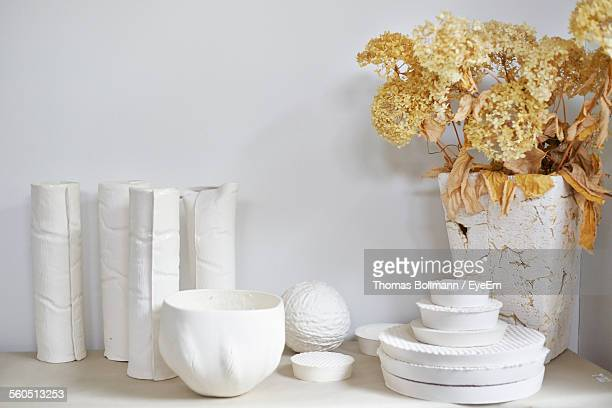 Pottery On Shelves With Flower Vase