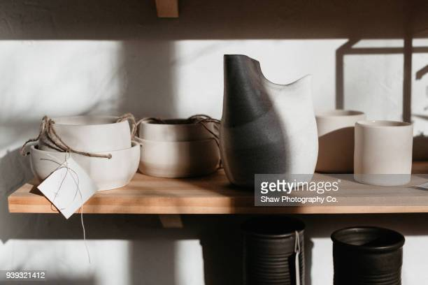 pottery sunlight shelf - ceramics stock pictures, royalty-free photos & images